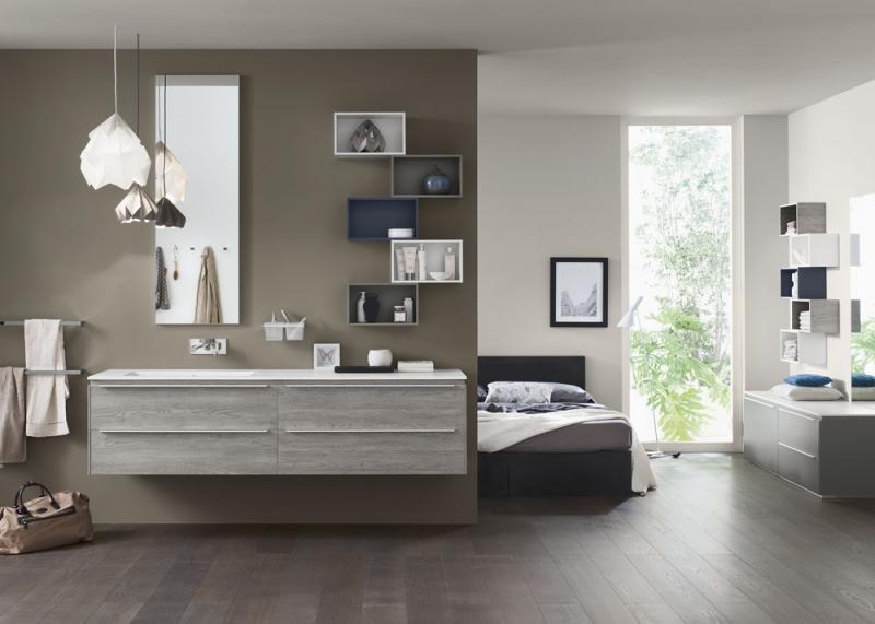 Sestava koupelnového nábytku Proggetto+, dvě umyvadlové skříňky v dřevěném dekoru se dvěma zásuvkami, 100 x 48 cm, police 40 x 28 cm, nástěnné zrcadlo 144 x 48 cm, Inda, ceny: skříňka 28 425 Kč, polička od 7 420 Kč, zrcadlo 7 081 Kč, www.designbath.cz