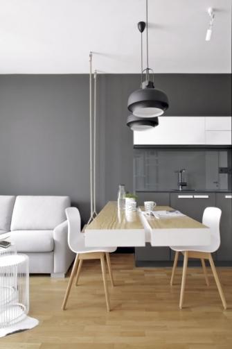 """Stůl """"zakousnutý"""" do kuchyňské linky bylo možné díky zabudované konstrukci nechat levitovat v prostoru, což umožňuje usadit návštěvu do čela stolu"""
