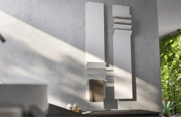Je čas začít myslet na teplo v koupelně. Co říkáte na tyto designové radiátory Flaps, které jsou dílem bulharského designéra Viktora Vasileva. Ten se při jejich návrhu inspiroval leteckými klapkami na křídlech, jež na radiátorech slouží jako odkládací plocha na ručníky a současně díky nim proudí do místnosti teplý vzduch. Radiátory jsou vyrobeny z hliníku a mají velmi nízký objem vody. Lze je připojit do systému ústředního topení na vodu nebo zapojit do zásuvky elektrické sítě.