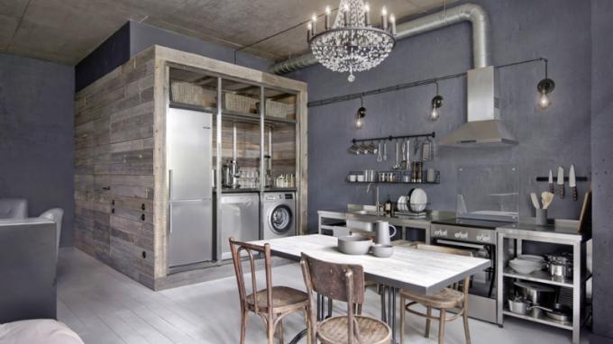 Architekti si pohráli s recyklovaným materiálem Greyboard. Kromě obložených stěn byl tento materiál použit pro výrobu jídelního stolu, regálů či různých úložných beden