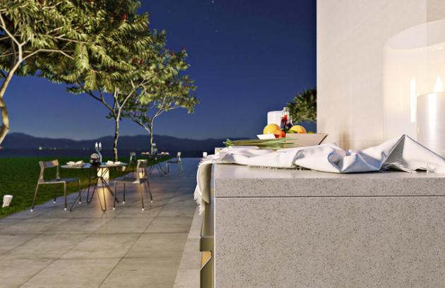 Venkovní kuchyně zvysoce odolného tvrzeného kamene TechniStone®  doprostředí zahrady skvěle zapadne  azajistí útulný kout ipod širým nebem,  více nawww.technistone.com