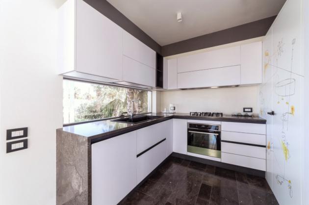 Mramor je nositelem architektonické funkce a zdůrazňuje dokonalou harmonii mezi prostory.