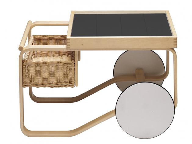 Tea Trolley 900 (Artek), ohýbaný březový rám, ručně vyráběný ratanový koš, vrchní deska sdlaždicemi, 90 × 60 ×65cm, cena 82706Kč,  www.designbuy.cz