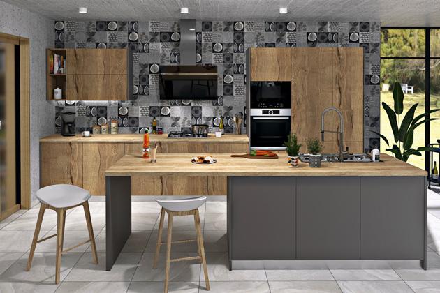 Mabel je zástupcem jednoduché, stylově čisté kuchyně. Hlavním výrazovým prvkem je tzv. synchronizovaný pór na čelních dvířkách, všechny letorosty dřeva na dveřích jsou svislé a plynule na sebe navazují. Dvířka se ovládají pomocí stisku, a to buď díky systému Blum Tip-On, nebo systému Servo-Drive (lednice). Čelní plochy – lamino Sherwood Kensington park, MDF prachově šedá perfekt mat, pracovní deska dub Hamilton
