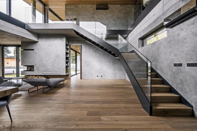 Kvalitní velkoplošná okna v hliníkovém rámu jsou důležitou součástí koncepce založené na maximálním propojení interiéru s exteriérem