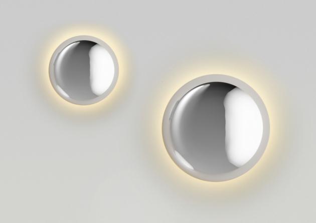 Svítidla zkolekceBabilaevokují kapky vody, na jejichž povrchu se panoramaticky zrcadlí odraz okolí. Výrazné čočky zleštěnéoceli jsou zároveň světlem i architektonickým prvkem.