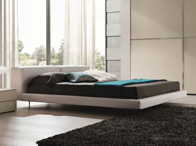 Moderní a příjemná postel Zenit (Désirée) s měkkým čelem inspirovaným pohodlnou pohovkou.